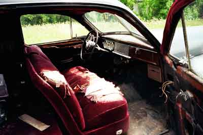 Image of chewed up interior of a neglected 1949 Henney Packard hearse.