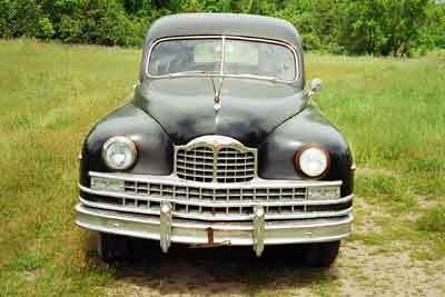 Front end image of a 1949 Henney Packard hearse, comin' at ya.