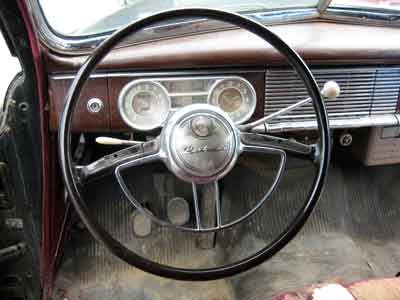Image of 1949 Henney Packard hearse's steering wheel and instrument cluster.